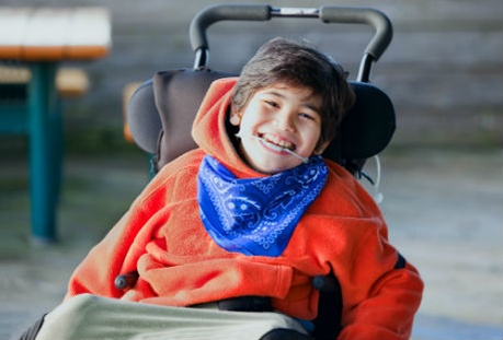 young boy in wheelchair